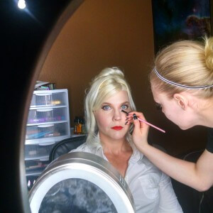 Finishing makeup touches by Cheyenne Evans on Cheryl Honc of Belegenza.  Hair by Alan Eschenburg.